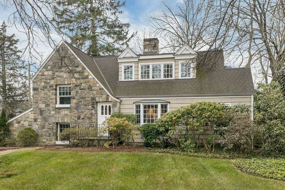 Listed for $1.679 million, 2 Spruce St. in Riverside is sited on a 0.30-acre lot. The three-bedroom Cotswold-style home was renovated and expanded in 2007 by local architect Laura Kaehler. Photo: Sotheby's International Realty / ONLINE_CHECK