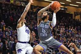 MANHATTAN, KS - DECEMBER 15: D'Marcus Simonds #15 of the Georgia State Panthers drives to the basket against Xavier Sneed #20 of the Kansas State Wildcats during the first half on December 15, 2018 at Bramlage Coliseum in Manhattan, Kansas. (Photo by Peter G. Aiken/Getty Images)