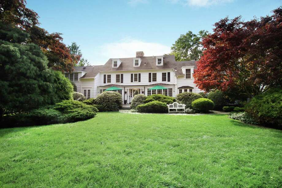 The circa 1850 vintage colonial estate at 27 Rimmon Road in Woodbridge is completely restored. The 2.45-acre setting is surrounded by magnificent gardens, rolling lawns, a pond and a spectacular two-story carriage house. Photo: Coldwell Banker Residential Brokerage