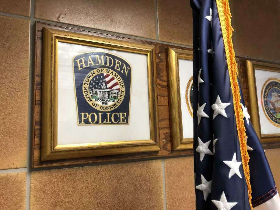 A logo for the Hamden Police Department, as seen in the government center. Photo: Ben Lambert / Hearst Connecticut Media