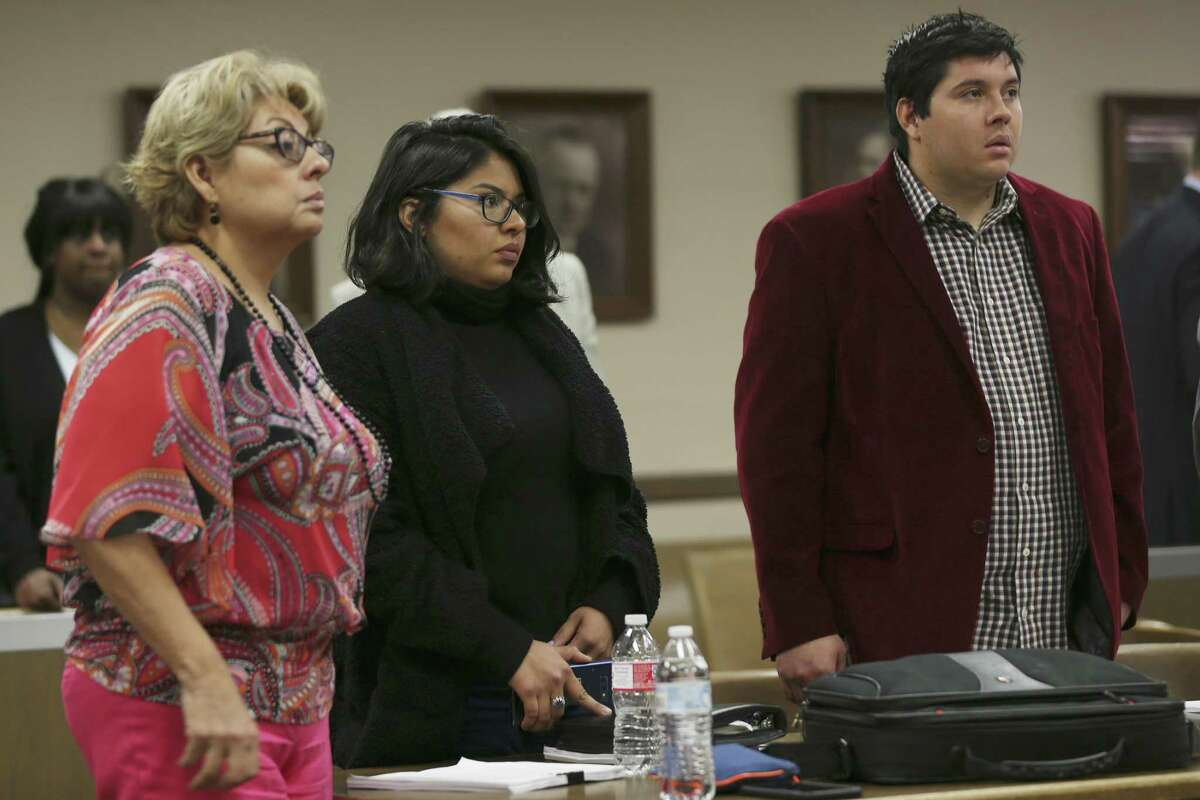 Joe Martinez Thrash, 27, right, and his sister, Brittany Martinez Thrash, 25, stand with their mother, Laura Martinez, 54, as Bexar County 73rd District Court Judge David Canales enters the courtroom during an adoption hearing, Tuesday, March 19, 2019. The guardians of incapacitated Charlie Thrash, 81, took the siblings to court to have their adoptions by the elder Thrash nullified. Their mother married Thrush in five-minute ceremony on March 4th and the next day he adopted her adult children. Last Friday, Judge Oscar Kazen annulled the marriage. During the adoption hearing, Canales ruled in favor of the guardians and nullified the adoptions.