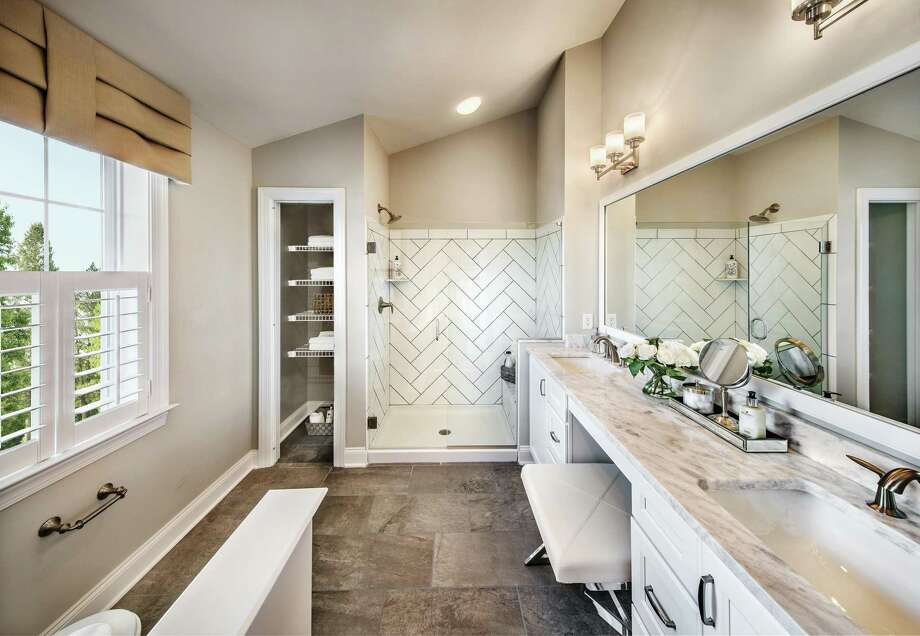 Hundreds of amazing designer finish options are available to home buyers to enhance the kitchen and baths in their new home, from flooring and fixtures. Photo: William Taylor / ONLINE_CHECK