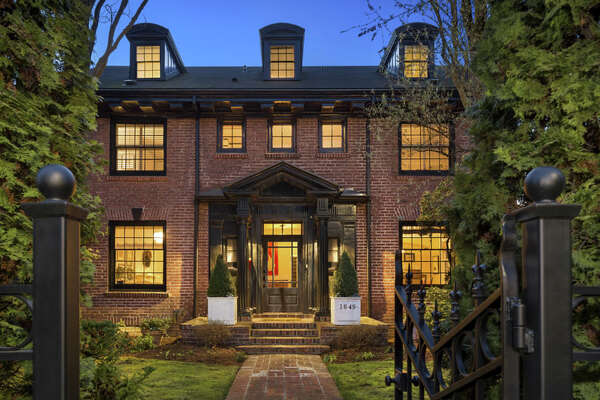 This 1913 brick colonial home in Seattle's Capitol Hill neighborhood includes stunning views as well as a classic style that reflects the early 20th century design of the home.