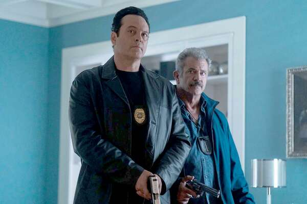 "Vince Vaughn, left, and Mel Gibson play cops who turn to crime after they are suspended in ""Dragged Across Concrete."""