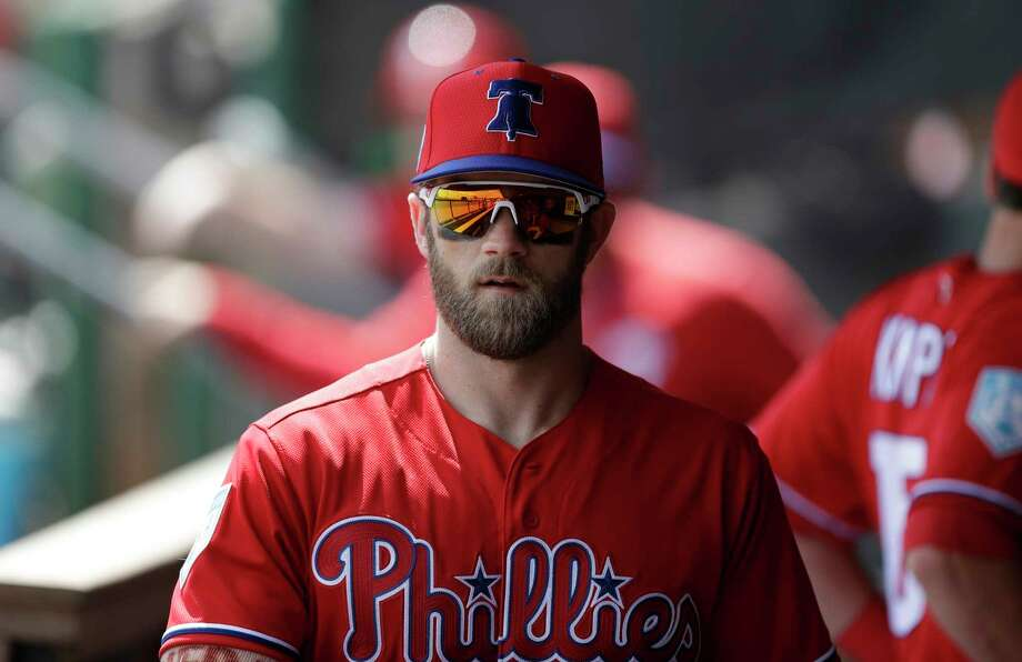 FILE - In this March 11, 2019 file photo Philadelphia Phillies right fielder Bryce Harper walks in the dugout before a spring training baseball game against the Tampa Bay Rays in Clearwater, Fla. Harper came to Philadelphia to do the one thing he didn't accomplish in Washington: Win in October. The Phillies gave him the biggest contract in baseball history to deliver. The 26-year-old slugger was a six-time All-Star, 2012 NL Rookie of the Year and 2015 NL Most Valuable Player during seven seasons with the Nationals. But he couldn't help Washington win a postseason series in four tries. Photo: Chris O'Meara, AP / Copyright 2019 The Associated Press. All rights reserved.