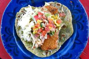 A deluxe fish taco on a tomatillo cilantro tortilla from the Austin-based Cabo Bob's Burritos, which is set to open its San Antonio location Tuesday.
