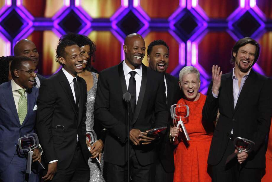 """In Living Color"" cast members at a TV Land event in 2014, from left, are Tommy Davidson, David Alan Grier, Marlon Wayans, Kim Wayans, Keenen Ivory Wayans, Shawn Wayans, Kelly Coffield Park and Jim Carrey. Photo: Jason DeCrow / AP / FR103966 AP"