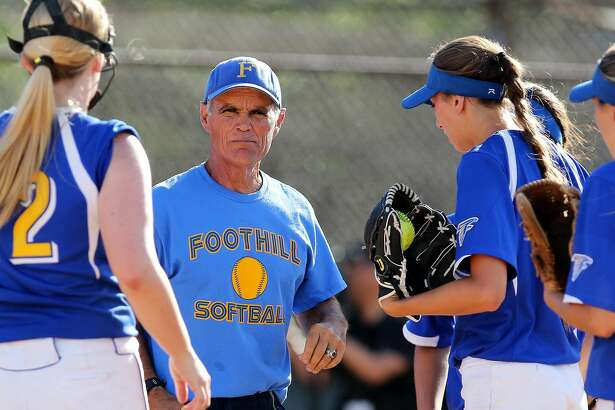 Foothill softball coach Matt Sweeney surrounded by players in June 2016.