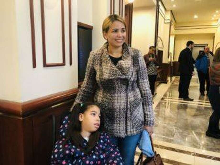 Gislene Batista stands with her 11-year-old daughter, Emily, outside a hearing room Tuesday. Batiste, who came to the United States two months ago, is pressing for state-funded health coverage for undocumented children like Emily. Photo: Jenna Carlesso / CTMirror.org
