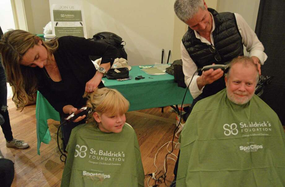 Head shaving was underway at the St. Baldrick's Foundation fundraiser at St. Francis of Assisi Church in Weston on March 16, 2019. Photo: Nicole Zappone / For Hearst Connecticut Media