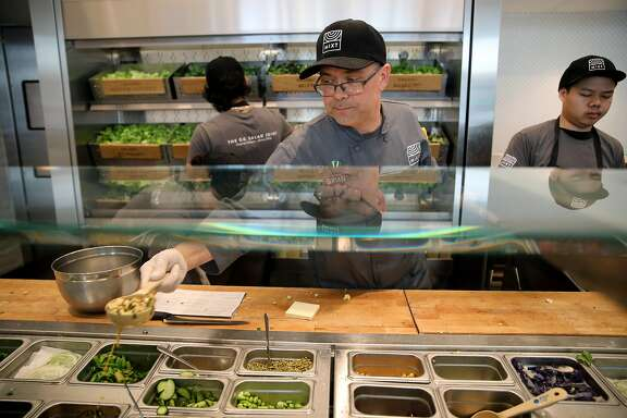 Brian Baronowski, general manager at Mixt Greens, located at 901 Valencia St., builds a salad in San Francisco, Calif., on Tuesday, March 19, 2019. The local salad chain is opening its first two new East Bay locations next month in Oakland and San Ramon. But Mixt also has national ambitions, with a Texas restaurant opening on May 18.