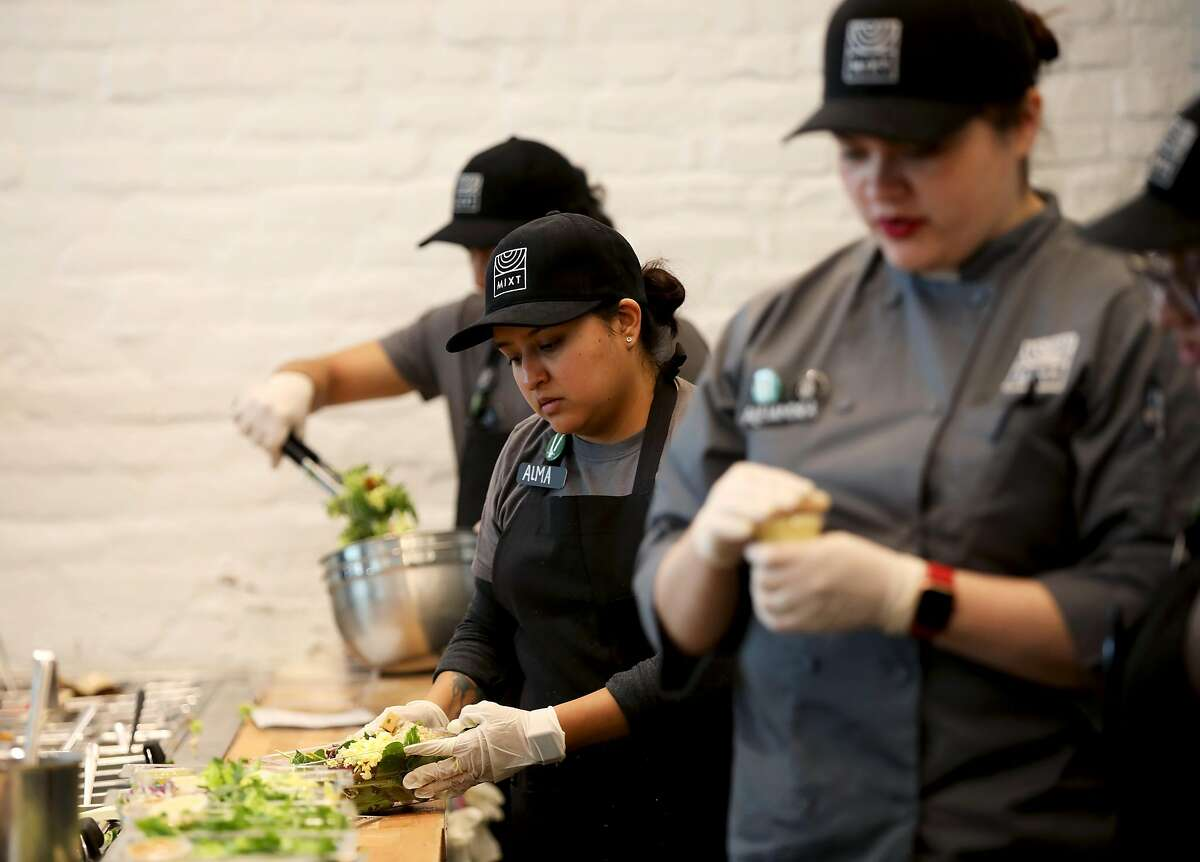 Salad chefs build salads at Mixt Greens, located at 901 Valencia St., in San Francisco, Calif., on Tuesday, March 19, 2019. The local salad chain is opening its first two new East Bay locations next month in Oakland and San Ramon. But Mixt also has national ambitions, with a Texas restaurant opening on May 18.