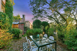 A European-style villa at 2772 Hilgard Ave. in the Berkeley Hills has a flexible flood plan that allows it to be used as three separate apartments or a single family home.