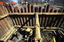Workers excavate a collapsed sewer pipe thirty two feet below Pershing Drive in Ansonia in March.