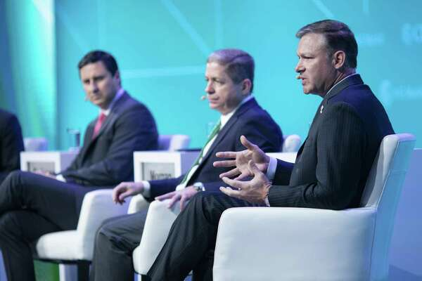 Eric Silagy, president and chief executive officer of Florida Power & Light Co., right, speaks as Mauricio Gutierrez, president and chief executive officer of NRG Energy Inc., left, and Curtis Morgan, president and chief executive officer of Vistra Energy Corp., center, listen during the 2019 CERAWeek by IHS Markit conference in Houston, Texas, U.S., on Thursday, March 14, 2019. The program provides comprehensive insight into the global and regional energy future by addressing key issues from markets and geopolitics to technology, project costs, energy and the environment, finance, operational excellence and cyber risks. Photographer: F. Carter Smith/Bloomberg