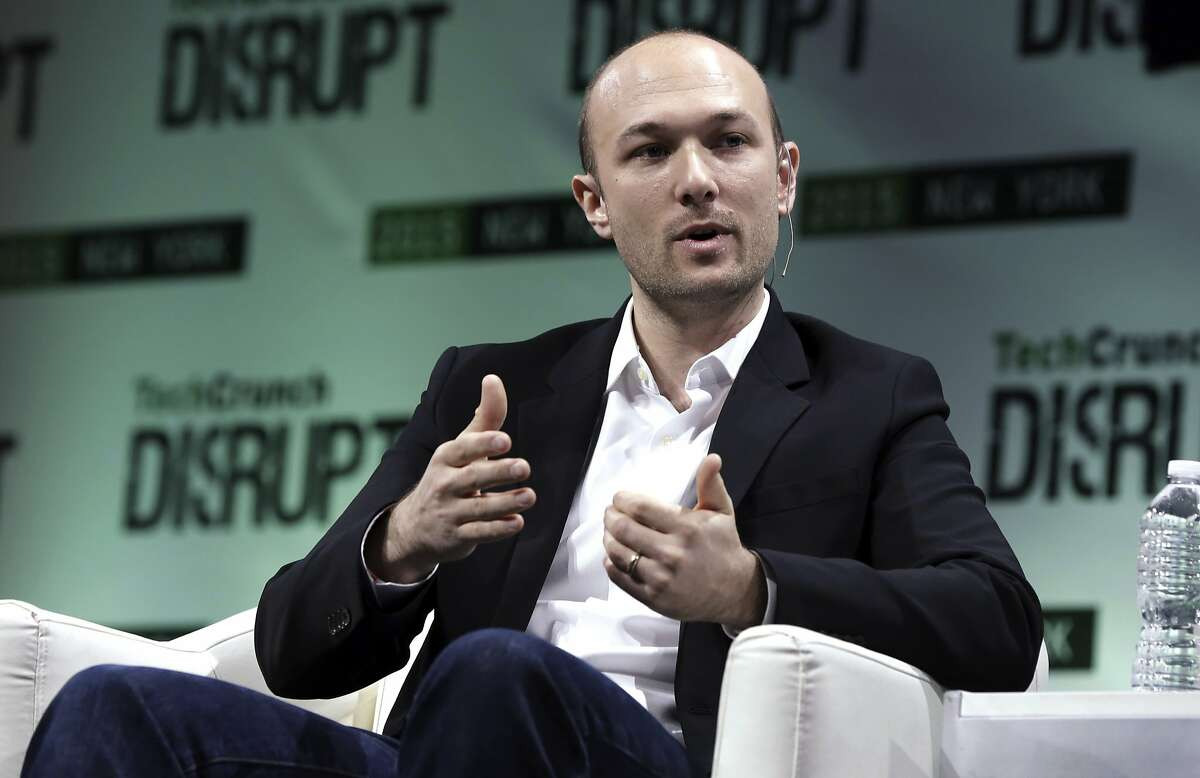 FILE - In this May 5, 2015, file photo, Lyft co-founder Logan Green speaks at TechCrunch Disrupt NY event, in New York. Ride-hailing giant Lyft is releasing financial details about the company in a federal filing before it begins selling its stock to the public. (AP Photo/Richard Drew, File)