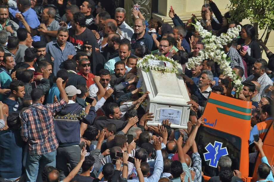 Coptic Christians carry the coffins of victims killed in an attack a day earlier,following a morning ceremony at the Prince Tadros church in Egypt's southern Minya province, on Nov. 3, 2018. Gunmen attacked a bus carrying Coptic Christians in central Egypt, killing seven in the latest assault on the religious minority claimed by the Islamic State (IS) group. The attackers opened fire on the bus of pilgrims in Minya province after the occupants had visited the Saint Samuel monastery, the local bishop told AFP. Photo: MOHAMED EL-SHAHED / AFP /Getty Images / AFP or licensors