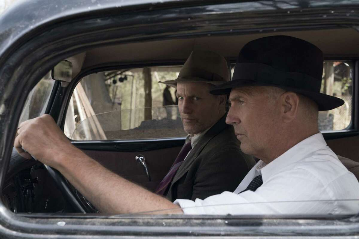 Kevin Costner, foreground, and Woody Harrelson star in