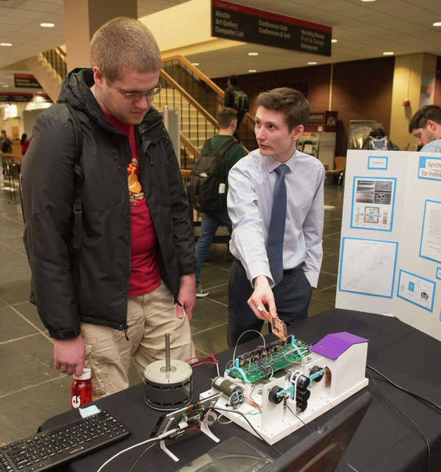 Jack White, an electrical engineering master's candidate from O'Fallon, Ill., discussed his research project with fellow student Steven Slaby, of Edwardsville, during the SIUE Graduate School Spring Symposium. Photo: For The Intelligencer