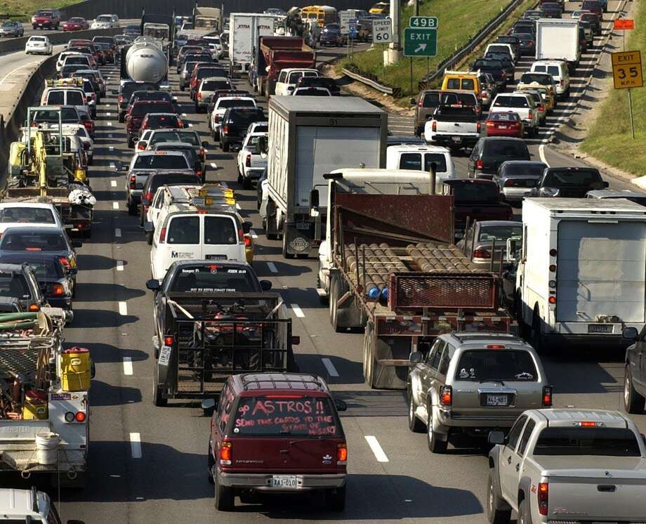 """Houston traffic can put anyone in a state of misery. But in a jam, as previously mentioned, you can always find an Astros fan, like this one on Interstate 45 with a sign that reads, """"Go Astros send the cards to the state of misery."""" Photo: Carlos Antonio Rios, Staff / Houston Chronicle / Houston Chronicle"""