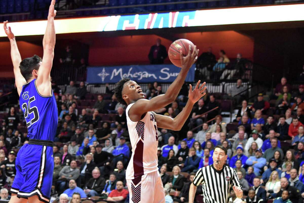 Innovation's Linwood Hazelwood goes for a layup during the Division V championship at Mohegan Sun March 17.