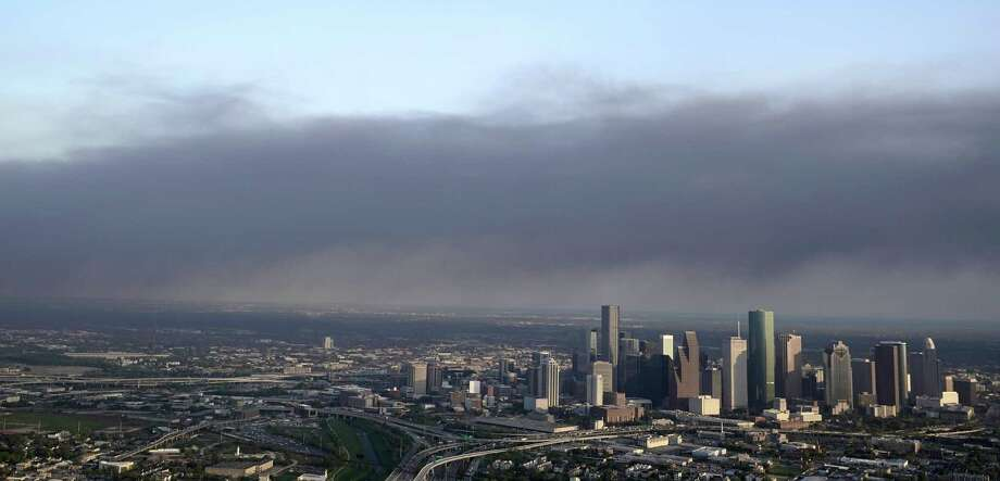 A plume of smoke from a petrochemical fire at the Intercontinental Terminals Company is shown over downtown Houston Monday, March 18, 2019. The large fire at the Houston-area petrochemicals terminal will likely burn for another two days, authorities said Monday, noting that air quality around the facility was testing within normal guidelines. (AP Photo/David J. Phillip) Photo: David J. Phillip, STF / Associated Press / Copyright 2019 The Associated Press. All rights reserved