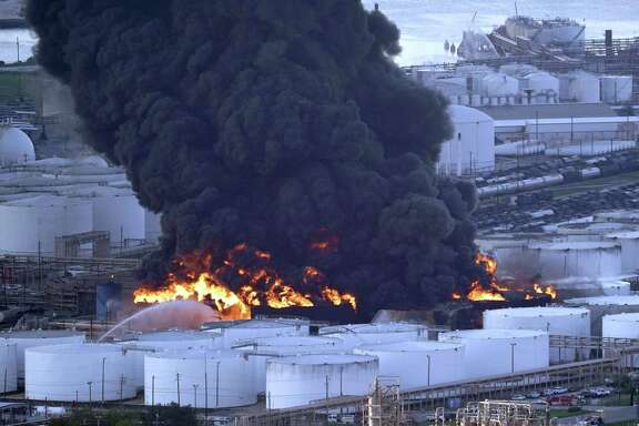 Firefighters battle a petrochemical fire at the Intercontinental Terminals Company Monday, March 18, 2019, in Deer Park, Texas. The large fire at a Houston-area petrochemicals terminal will likely burn for another two days, authorities said Monday, noting that air quality around the facility was testing within normal guidelines. (AP Photo/David J. Phillip)