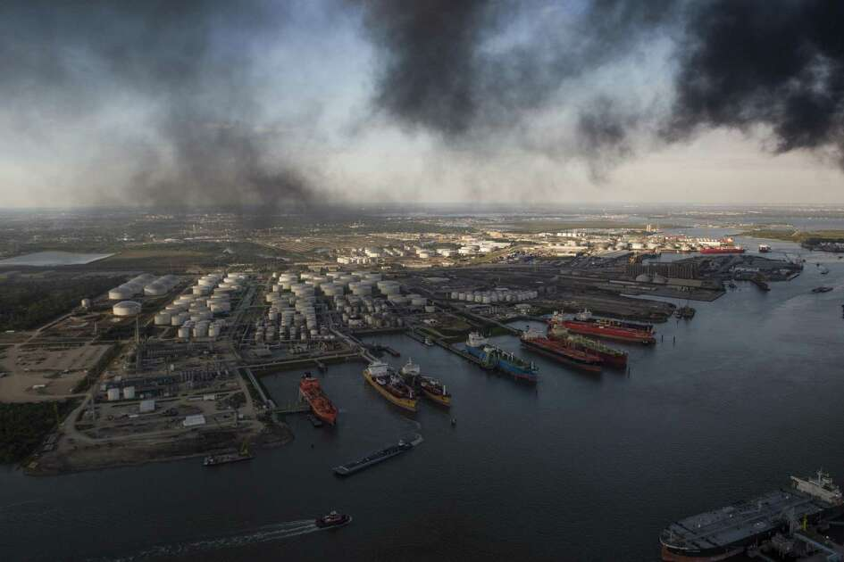 View of the Houston Ship Channel and a smoke cloud caused by a fire at a petrochemical plant on Monday, March 18, 2019, in Deer Park.
