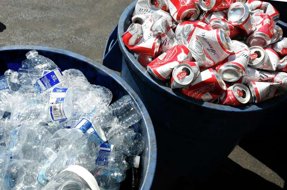 FILE — Cans and bottles are piled in bins to be recycled. (AP Photo/Rich Pedroncelli) Photo: Rich Pedroncelli / Copyright 2016 The Associated Press. All rights reserved.