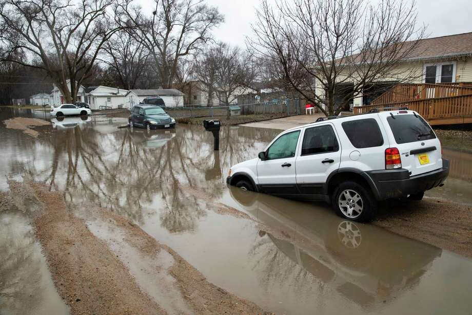 Cars are stuck in floodwaters Tuesday, March 19, 2019, in Fremont, Neb. Flooding is expected throughout the week in several states as high water levels flow down the Missouri River. Swollen rivers have already breached more than a dozen levees in Nebraska, Iowa and Missouri, according to the U.S. Army Corps of Engineers. (Brendan Sullivan/Omaha World-Herald via AP) Photo: BRENDAN SULLIVAN, AP / BRENDAN J. SULLIVAN