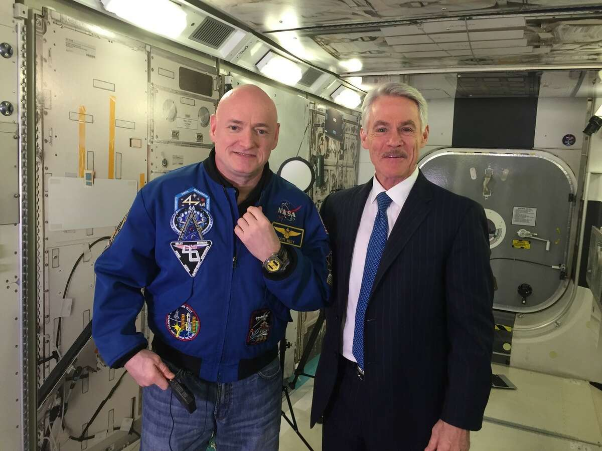 Astronaut Mike Finke helped me buy a hair dryer in Baikonur, Kazakhstan. I forgot to bring mine for my anchorman hair when we traveled there for the launch of Expedition 25. Pictured: I am standing with Expedition 25 crew member, astronaut Scott Kelly.