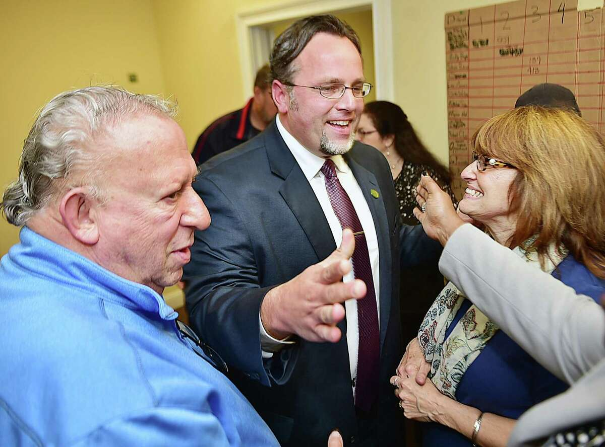 Mayor Curt Leng celebrates with Elliot Kerzner, left and his mother, Linda Leng, right, after defeating Republican Bob Anthony in the Hamden mayoral race Nov. 3, 2015.