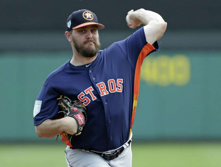 Houston Astros pitcher Wade Miley throws against the Atlanta Braves in the first inning of a spring baseball exhibition game, Monday, March 4, 2019, in Kissimmee, Fla. Photo: John Raoux, STF / Associated Press / Copyright 2019 The Associated Press. All rights reserved