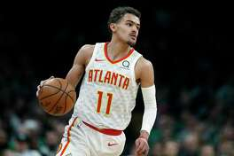 Atlanta Hawks' Trae Young (11) brings the ball up during the second half of an NBA basketball game against the Boston Celtics in Boston, Saturday, March 16, 2019. (AP Photo/Michael Dwyer)