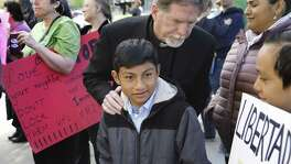 Rev. Jim Rigby of Saint Andrew's Presbyterian Church in Austin comforts 12-year-old Ivan Ramirez at a rally at the San Antonio ICE field office for Ramirez and his mother who are living in sanctuary at a church in Austin. Community members and faith leaders from the Austin Sanctuary Network and San Antonio held a rally outside the San Antonio ICE field office during the time of Alirio Gamez, Hilda Ramirez and her son Ivan's scheduled ICE check in to show their support, on Tuesday, March 19, 2019.