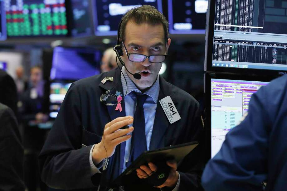 FILE- In this March 13, 2019, file photo Gregory Rowe works on the floor of the New York Stock Exchange. The U.S. stock market opens at 9:30 a.m. EDT on Tuesday, March 19. (AP Photo/Richard Drew, File) Photo: Richard Drew / Copyright 2019 The Associated Press. All rights reserved.