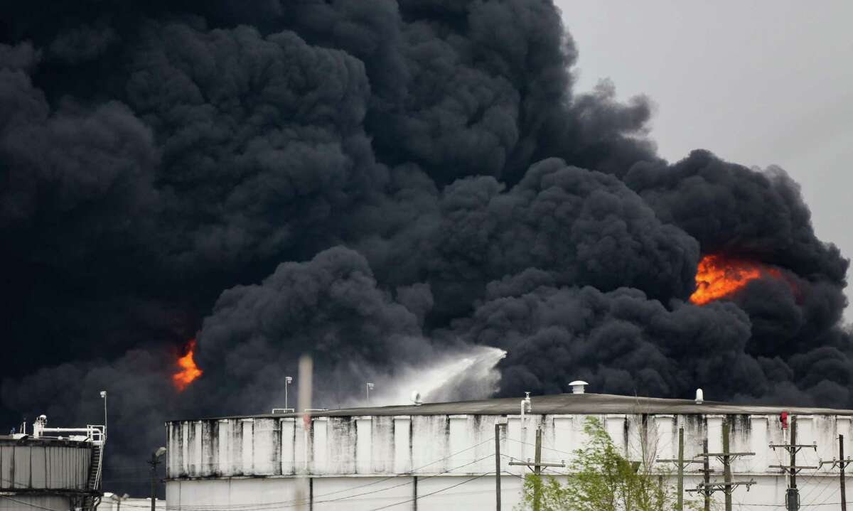Firefighters battle the petrochemical fire at Intercontinental Terminals Company on March 19, 2019, in Deer Park, Texas.
