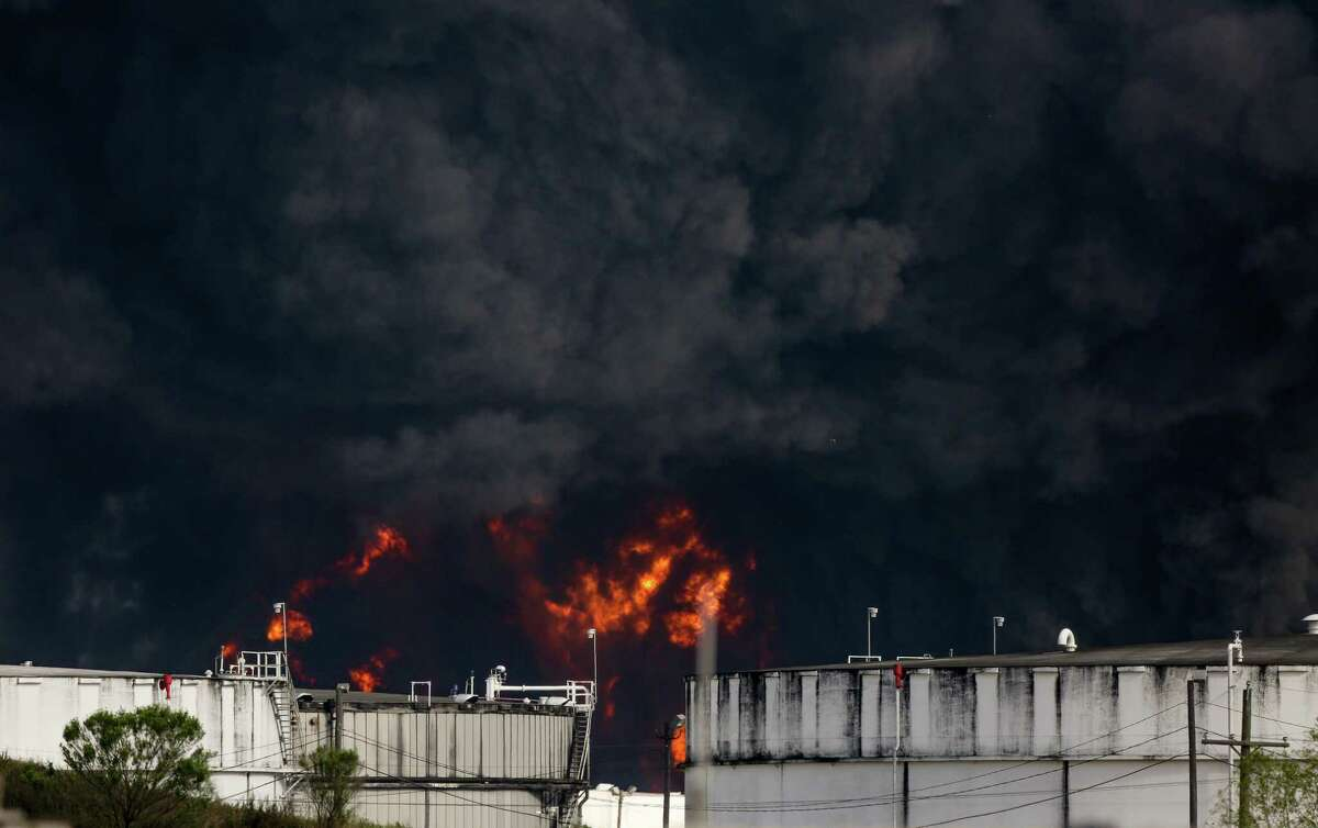 Firefighters continue to battle a petrochemical fire at Intercontinental Terminals Company, after it grew in size due to a lack in water pressure last night Tuesday, March 19, 2019, in Deer Park, Texas.