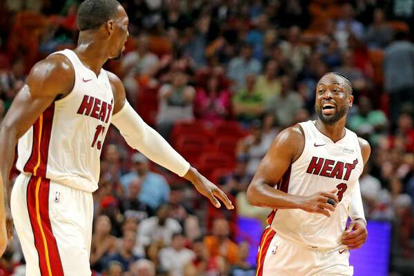 Miami Heat's Dwyane Wade (3) smiles at Bam Adebayo (13) after Wade hit a three-pointer late in the fourth quarter against the Charlotte Hornets on Sunday, March, 17, 2019 at the AmericanAirlines Arena in Miami, Fla. (Charles Trainor Jr./Miami Herald/TNS)