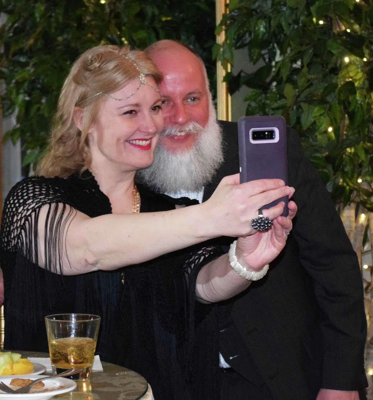 Spectrum/The New Milford Lions Club held a 90th gala celebration - based on a 1920s theme to recognize its 90th anniversary this year. Festivties were held at the Fox Hill Inn in Brookfield. Above, Carol and Aron Bowman, of Danbury, guests of Lion Maredith Spector, take a selfie during the cocktail hour.