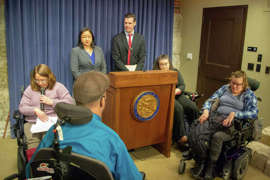 Disability self-advocate Megan Norlin (left) reads from a statement by fellow self-advocate Mary Hettel (right) at a press event Tuesday in the Capitol aimed at promoting legislation to phase out a program which allows certain employers to pay disabled workers far less than the statutory minimum wage. Photo: Jerry Nowicki | Capitol News Illinois