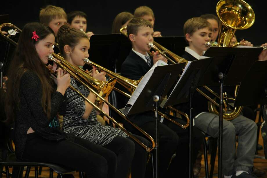 Bad Axe Middle School's fifth grade beginning band and sixth grade concert band performed Tuesday evening under the direction of Band Director George Smith. Photo: Kate Hessling/Huron Daily Tribune