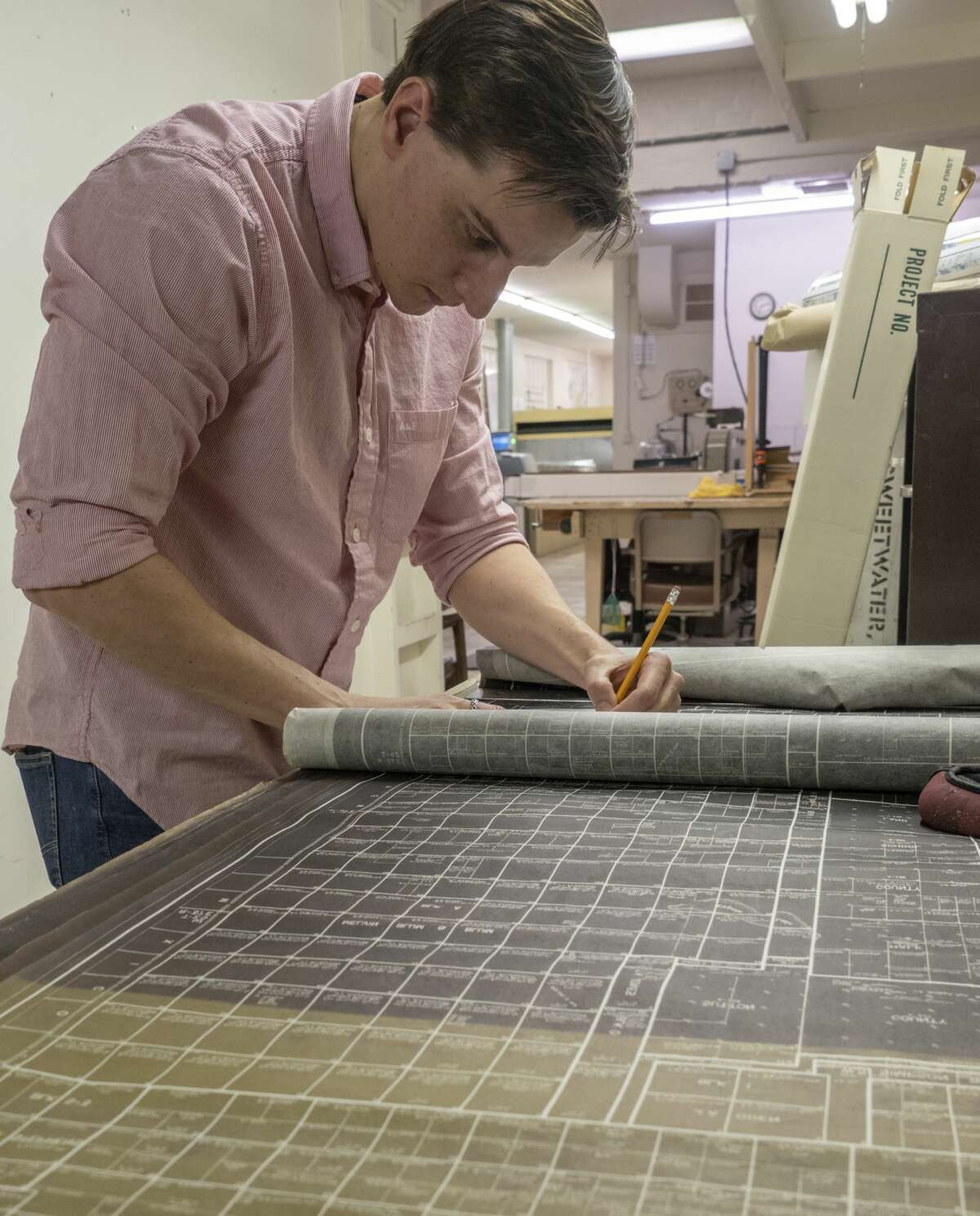 Geoffrey Dennis works on inventory of maps dating back to the 1950's 03/19/2019 at Midland Map Company, who is being bought by Drillinginfo. Tim Fischer/Reporter-Telegram