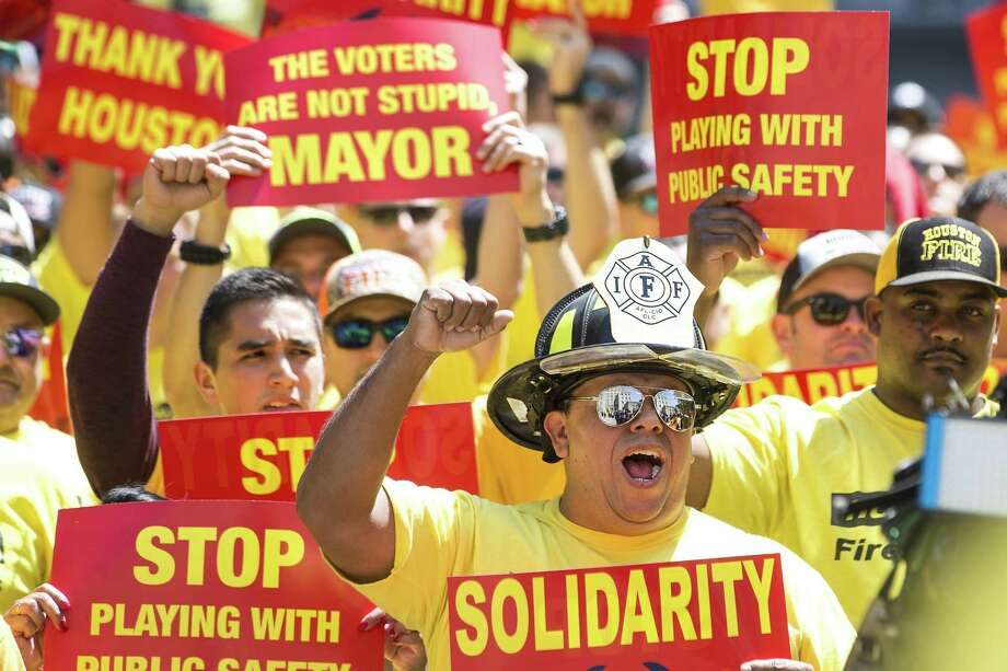 Houston firefighters demonstrate during a march on City Hall by the Houston Professional Fire Fighters Association over the labor dispute related to Proposition B on Tuesday, March 19, 2019, in Houston. Mayor Sylvester Turner recently told council members he intends to lay off up to 400 firefighters to fund the pay raises mandated by Prop. B. Photo: Brett Coomer, Houston Chronicle / Staff Photographer / © 2019 Houston Chronicle