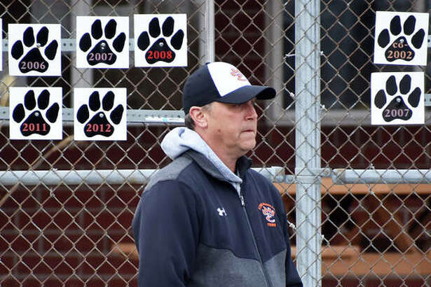 Edwardsville boys' tennis coach Dave Lipe watches a doubles match during the EHS-Alton match on Tuesday inside the EHS Tennis Center.