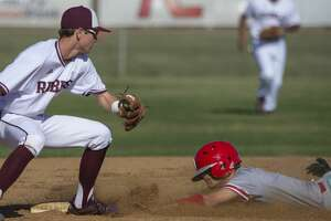Odessa High's Zach Attaway safely steals second as Lee High's Trevor Roper is late with the tag 03/19/2019 at Ernie Johnson Field. Tim Fischer/Reporter-Telegram