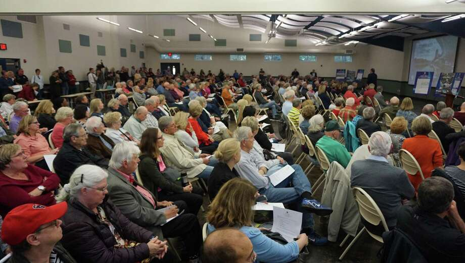 Residents interacted with The Herons Kingwood Marina's developer and associated experts at the community meeting on March 18, 2019 in Kingwood, TX. Photo: Nguyen Le / Staff Photo