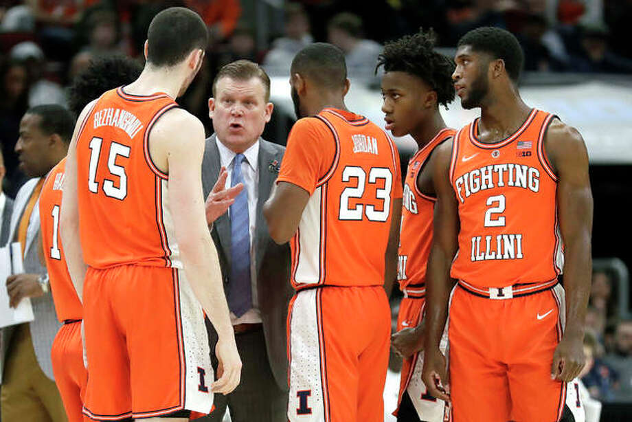 Illinois coach Brad Underwood talks to his players during the first half their Big Ten Conference Tournament game against Iowa last week in Chicago. Photo: AP Photo