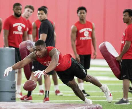 University of Houston cornerback Javian Smith drives for a ball as he runs a drill during the first day of spring practice on Tuesday, March 19, 2019, in Houston.