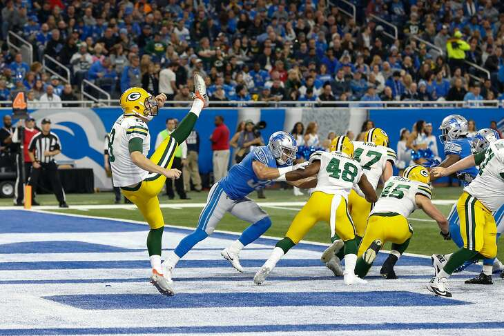 DETROIT, MI - DECEMBER 31:  Green Bay Packers punter Justin Vogel (8) punts the ball from the end zone during a game between the Green Bay Packers and the Detroit Lions on December 31, 2017 at Ford Field in Detroit, Michigan.  (Photo by Scott W. Grau/Icon Sportswire via Getty Images)